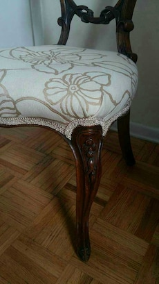 gray and brown floral suede padded brown wooden chair