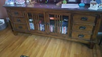 TV Console. Solid wood glass front doors.