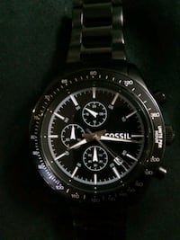 round black chronograph watch with silver link bracelet Calgary, T2K 4Y9