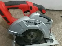 red and gray Skilsaw circular saw