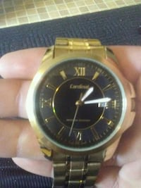 round gold-colored analog watch with link bracelet Abbotsford, V2S 2Z4