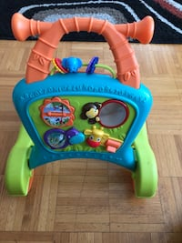 blue and yellow Fisher-Price learning walker Montréal, H3C 4S4