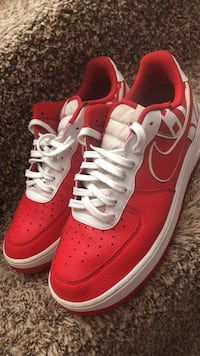 Pair of red-and-white nike sneakers Nashville, 37214