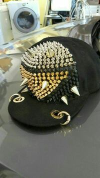 spike-studded black fitted cap