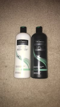 two white and black TRESemme Split Remedy bottles Pasadena, 21122