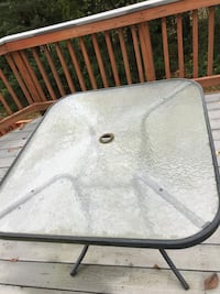 Black metal framed clear glass top patio table Chantilly
