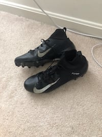 pair of black Nike cleats Sterling, 20165