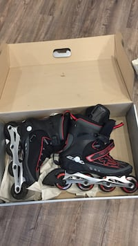 Pair of black-red-and-gray inline skates box