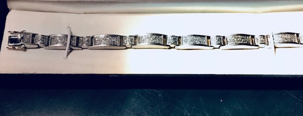 Diamond Bracelet with 620 natural, hand pronged diamonds set in a Sterling Alloy.
