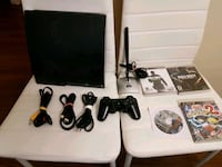 Sony PS3 slim console with controllers and g