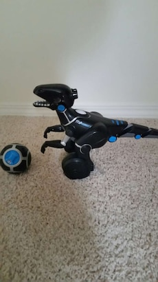 black and blue dinosaur plastic toy