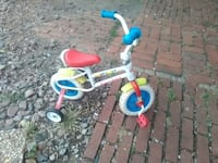 toddler's white and red trike