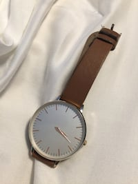 round silver analog watch with brown leather strap Toronto, M1C