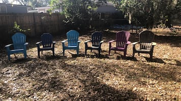 SIX Adirondack plastic chairs. 2 baby blue, 2 navy, 1 purple and 1 brown. The brown one is cracked but still can sit in it ( but I'm throwing that one in for free anyways).