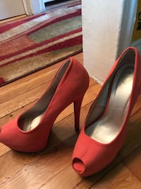 Pair of coral suede platform heeled shoes