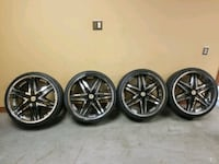 four chrome 5-spoke vehicle wheels and tires Knoxville, 37919