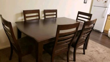 Large dining table with 6 chairs and leaf