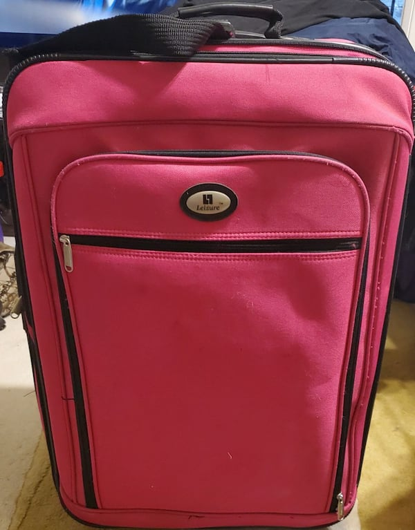 Pink Rolling Suitcase Luggage  a8872c29-95df-42ee-a981-ba505a6cedf0