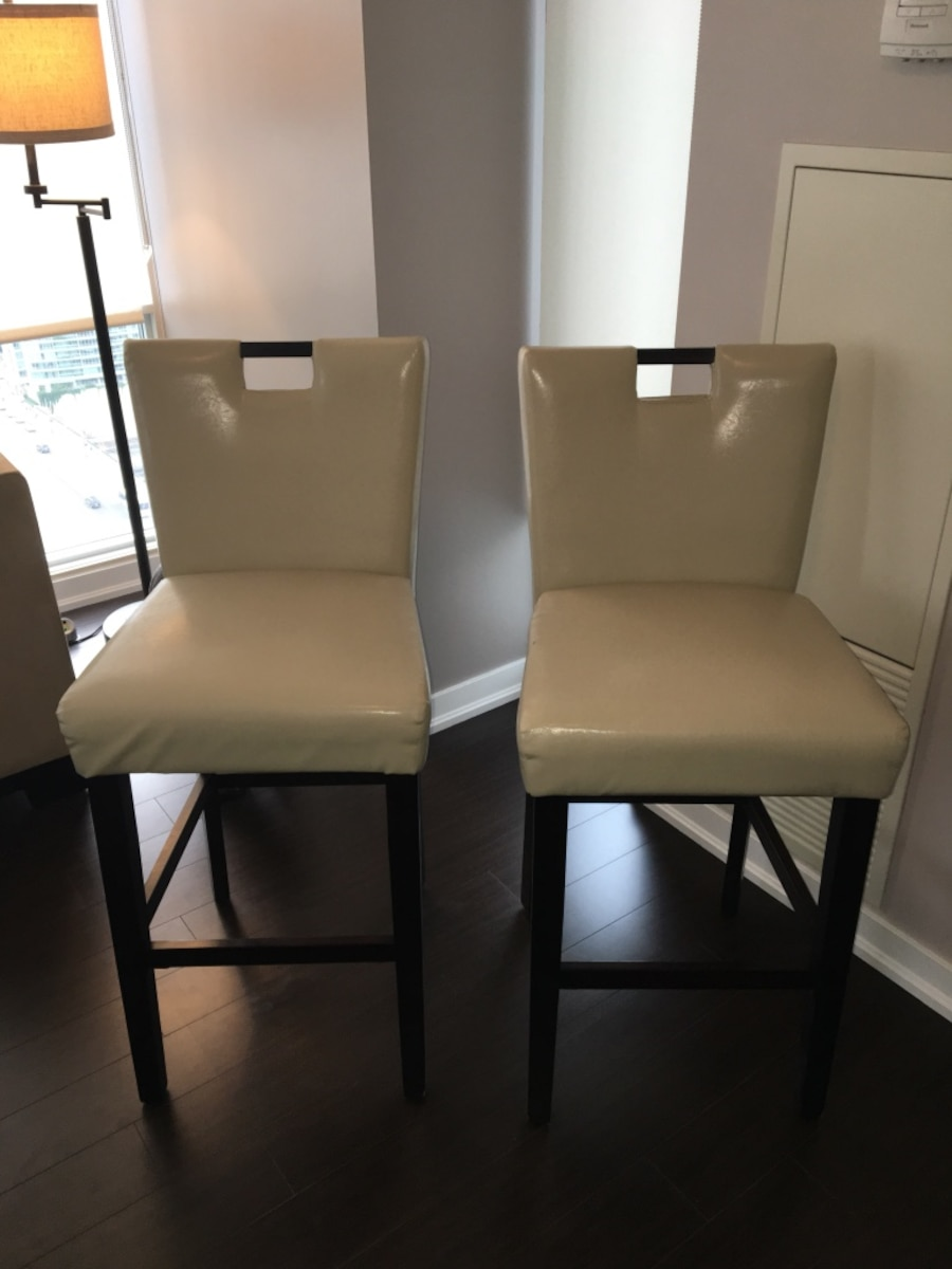 Two brown and beige armless chairs - $40