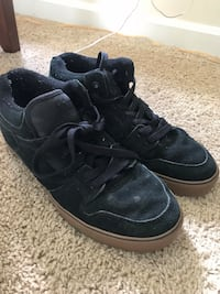 pair of black Nike high-top sneakers null