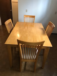 Solid Wood expandable Table & 4 chairs in good condition $300.00 OBO  Edmonton, T5E