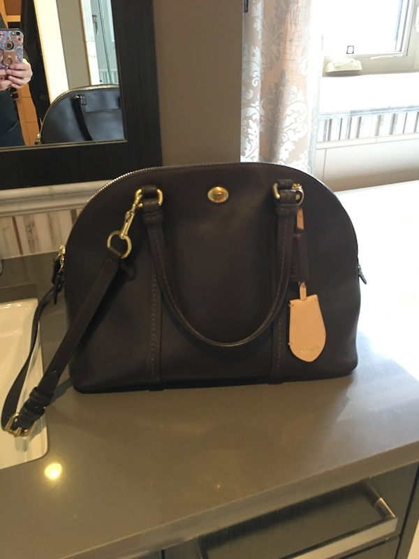 e9b2961efe59d Used Authentic Coach purse. Dark brown in color for sale in Calgary - letgo