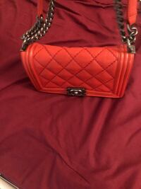 Authentic CHANEL Old Medium Boy True Red Quilted Calfskin with Ruthenium Hardware 2015. New York, 11103