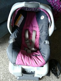 baby's grey and pink Graco car seat carrier