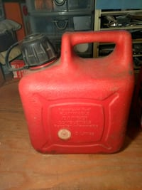 Red Plastic Gas Can $15.00 Firm