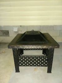 Metal fire pit still in box got 2 of them Winchester, 40391