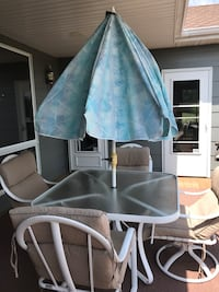 """48""""Milan patio set. 2 swivel rockers and 2 regular chairs with umbrella. Very good condition.  Norwalk, 50061"""