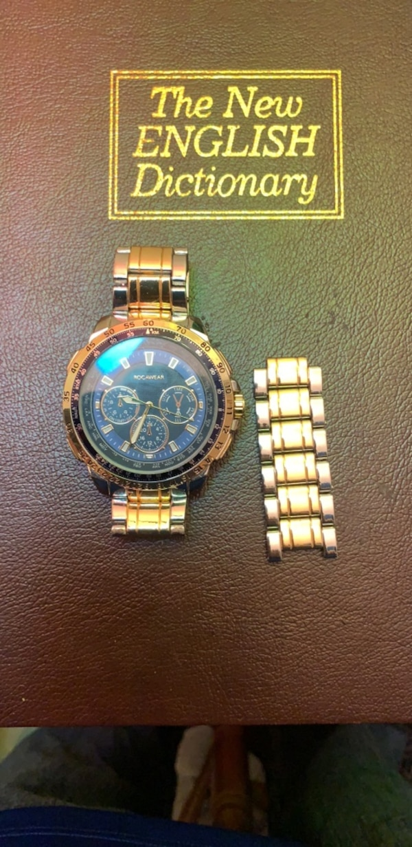 round gold chronograph watch with gold link bracelet