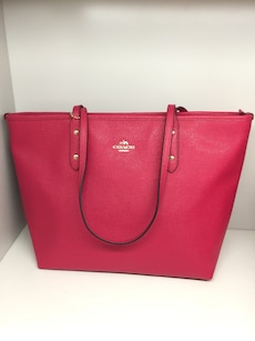 women's red Coach leather tote bag