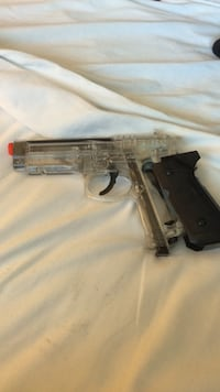 Black and clear plastic pistol air soft