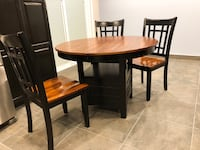 Round brown wooden table with four chairs dining set Windsor, N8P 1K8
