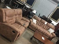 Bonded leather Reclining Sofa and Love Seat. Brand new.