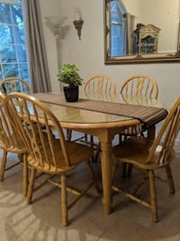 Oval brown wooden table with custom glass topper and six chairs dining set Modesto, 95356