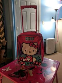 Child's rolling suitcase