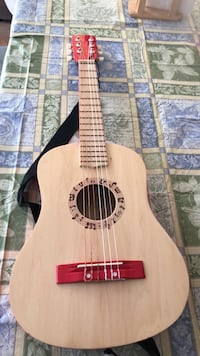 Beautiful child's guitar from Switzerland. ( agape Holding AG) Laval, H7T 1C8