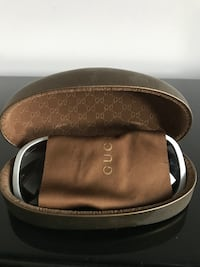 white framed Gucci over-sized sunglasses with wipes and clam case
