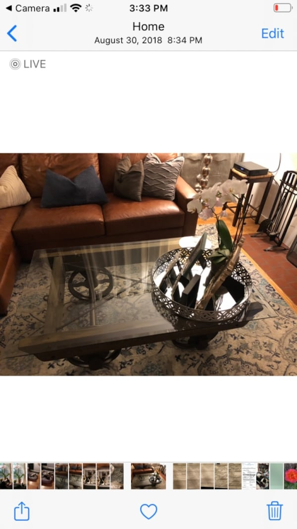 Glass coffee table - rail inspired wheels $400 or best offer  ed6cfa5a-248a-4f79-ac87-4b8dc4ee9431