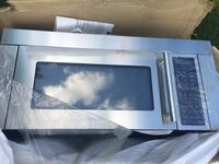 Gray and black microwave vent hood !Brand new ! Never installed! Springdale, 72762