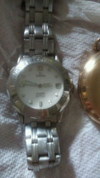 round silver-colored analog watch with link bracelet 377 mi