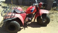 red and black Honda ATV Phoenix, 85029