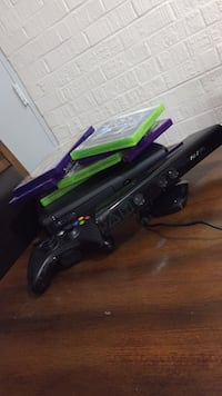 black Xbox 360 console with controller and game cases Naperville, 60565