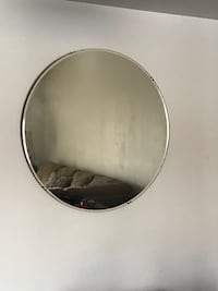 round silver-colored framed mirror 384 mi