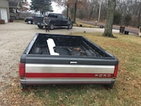 black, gray and red Ford truck bed