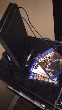 black Sony PS4 console with controller and game cases Chicago, 60618