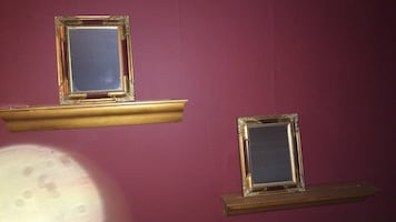 2 mirrors or 2 floating wood shelves