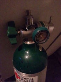 green and gray oxygen tank Channelview, 77530